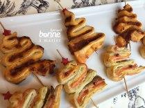 Amuse-bouches sapins feuilletés aux tomates séchées ou à la truite fumée